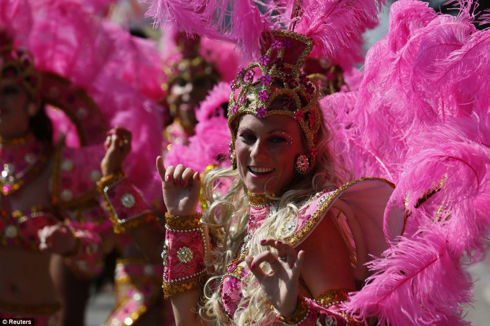 Pretty in pink: Europe's biggest street dance party was an array of bright colours today as hundreds of performers took to Notting Hill for the carnival