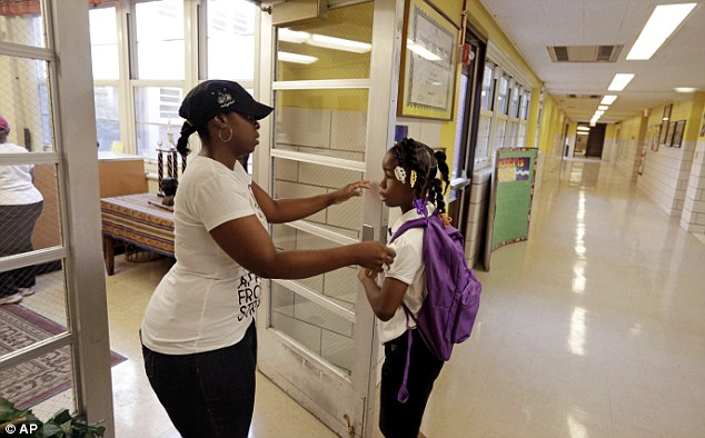 Crystal Stoval delivers her niece Kayla Porter to Gresham Elementary School on the first day of classes Monday, Aug. 26