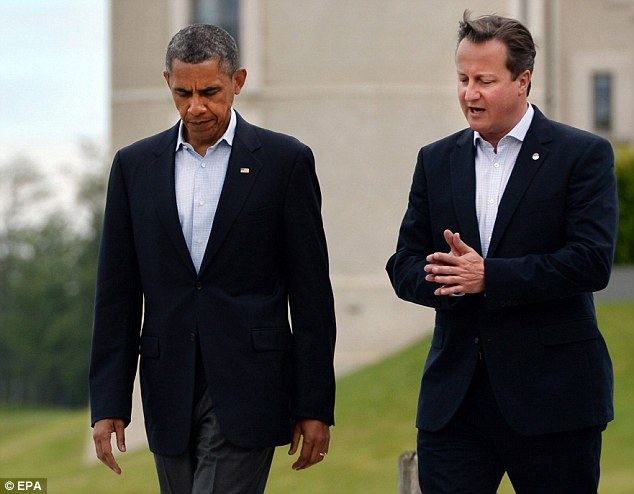 Talks: Prime Minister David Cameron (right) is expected to hold a second telephone call with US President Barack Obama (left) within the next 48 hours to finalise plans for military action (file picture)