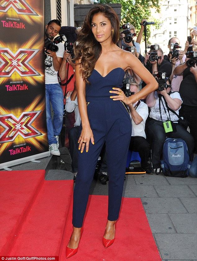 In Nicole's navy: Scherzinger stuns in a blue jumpsuit as she leads the glamour at Thursday morning's press launch of the new X Factor series