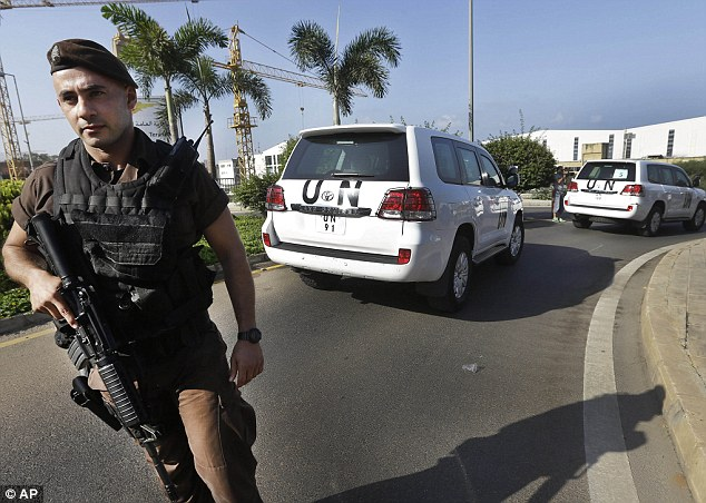 Departure: A Lebanese special forces policeman escorts the U.N. vehicles at Beirut international airport