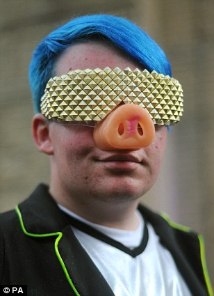 A Lady Gaga fan poses as he wait in line outside the Roundhouse