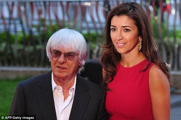 The Boss: And F1 chief Bernie Ecclestone (left, with Brazilian wife Fabiana Flosi)