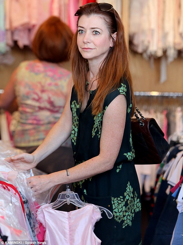 Bright eyes: Alyson wore a cute little summer dress for the shopping excursion