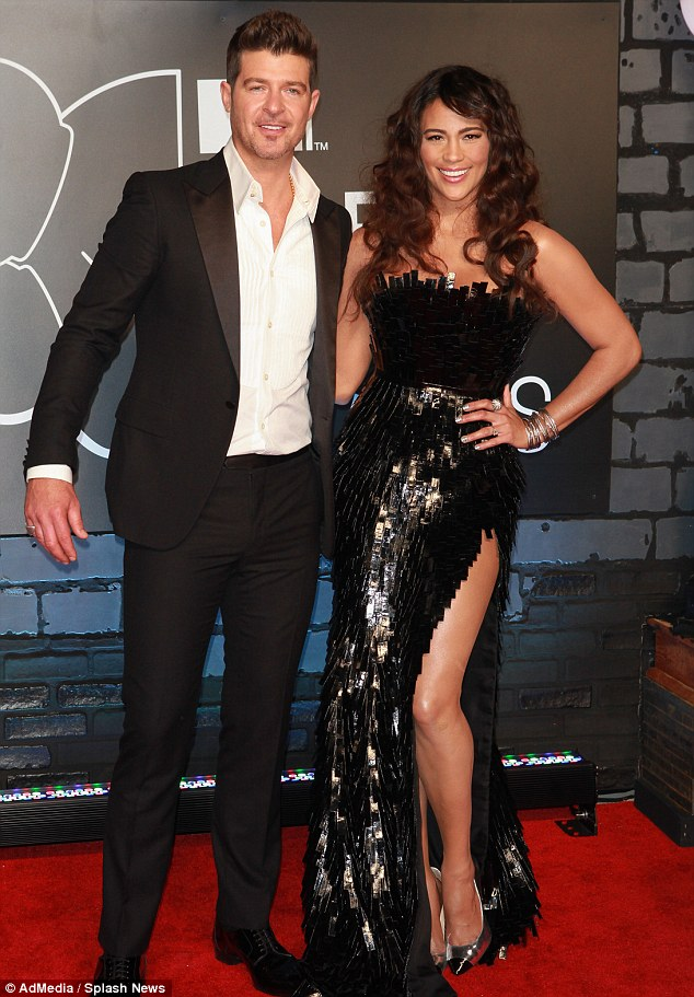 Happy couple? Robin and his wife Paula, seen here on the red carpet at last month's VMAs, have been married for 17 years