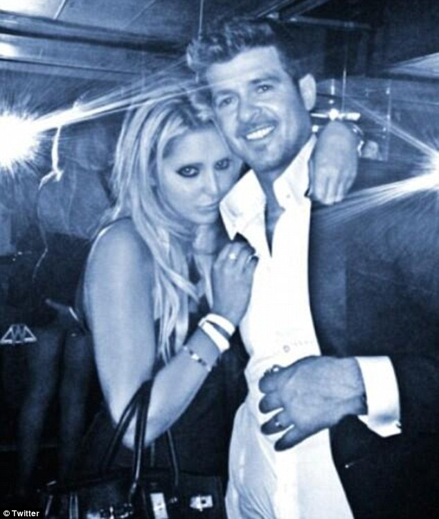 New claims: Lana Scolaro, who Robin Thicke inappropriately grabbed on the bottom at a VMAs after party last month, has now claimed that the singer also passionately kissed her that night
