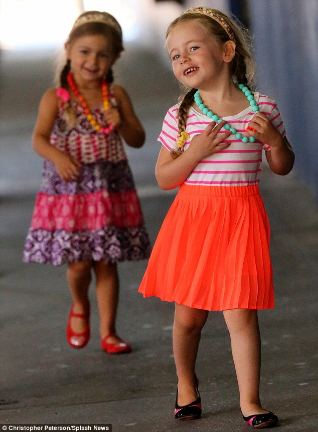 Model in the making: Marion showed a lot of modeling promise as she made sure to walk ahead of her sister stop, pose and show off her necklace