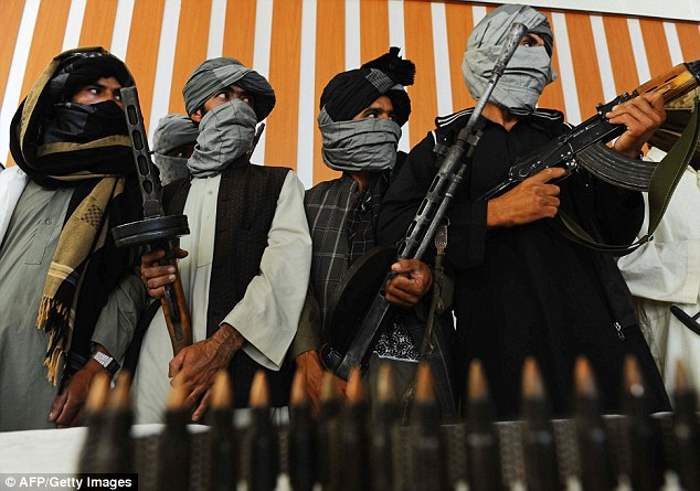 Combatants: Former Taliban fighters stand with their weapons during a ceremony after joining Afghan government forces in Herat on August 7, 2013 - In September 2012, Taliban soldiers attacked Camp Bastion dressed as American soldiers