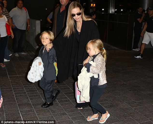 Golden wonder: Angelina Jolie's fair highlights shone as she marshalled ger twins Knox and Vivienne through LAX on Wednesday night