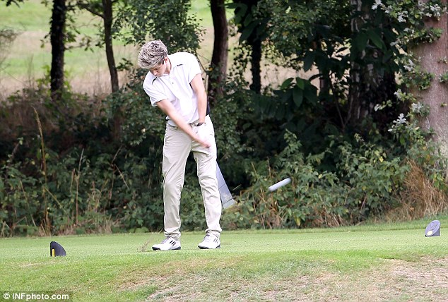 Irish heartthrob Niall practices his swing on Thursday