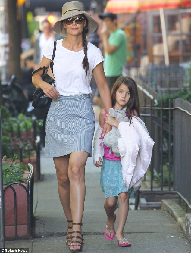 Soldering on: Suri Cruise was seen with a cast in New York on Wednesday after breaking her arm