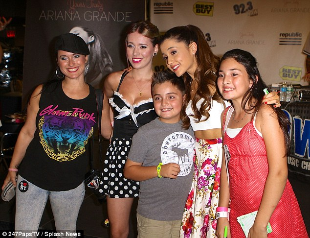 Say cheese! Grande posed with many New York fans at the signing Wednesday
