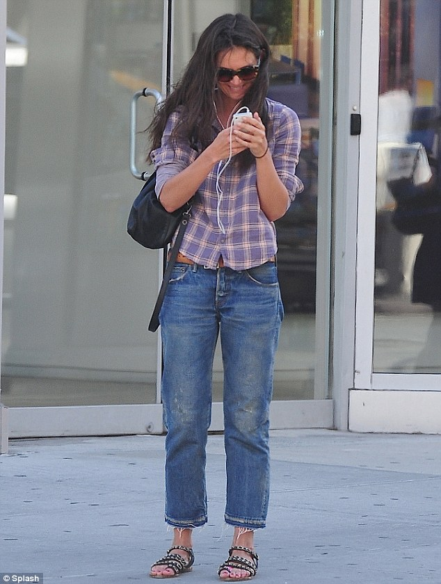 Happy to be back in plaid: Earlier in the day, Katie wore one of her favourite flannel shirts with baggy jeans