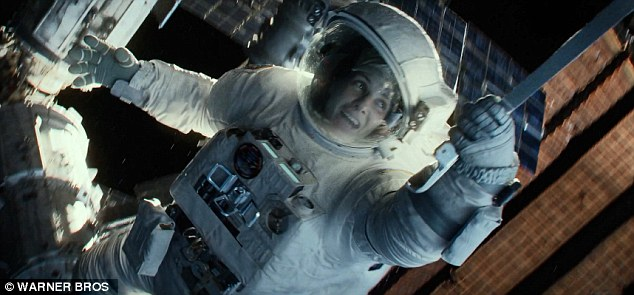 Coming October 4! The visual effects-heavy 3D film also stars George Clooney and was helmed by Alfonso Cuarón