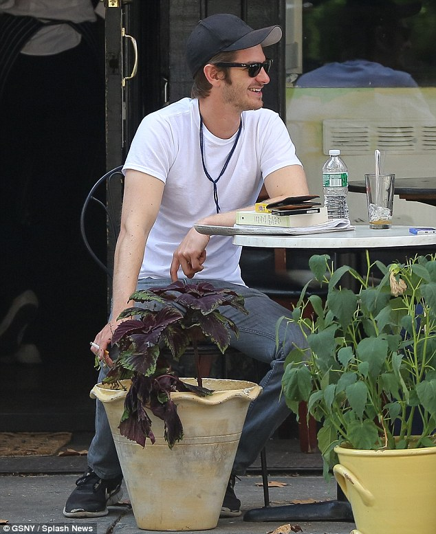 Smiler: Andrew grinned at his male acquaintance as they finished up their meal together