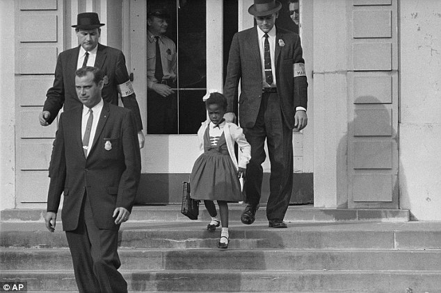 Ruby Bridges, 6, required three U.S. Marshals to escort her into Williant Frantz Elementary School in New Orleans, Louisiana, in 1960