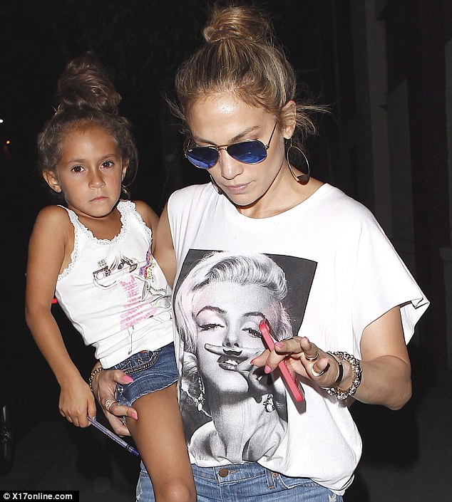Just like Mommy! Jennifer Lopz and daughter Emme sported matching top knot hairstyles and denim shorts as they headed out in Los Angeles on Thursday night