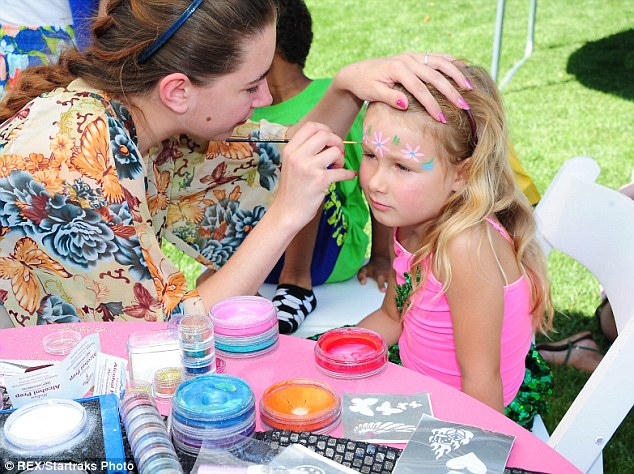 Painted lady: Stella had her face painted with pretty pink and blue flowers at the party