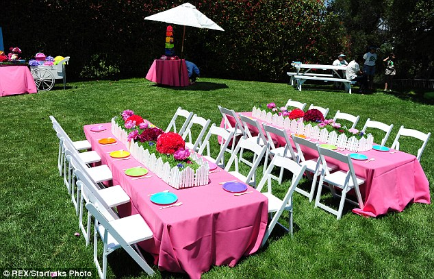 Garden party: The children were seated at pretty tables in the garden for their meal