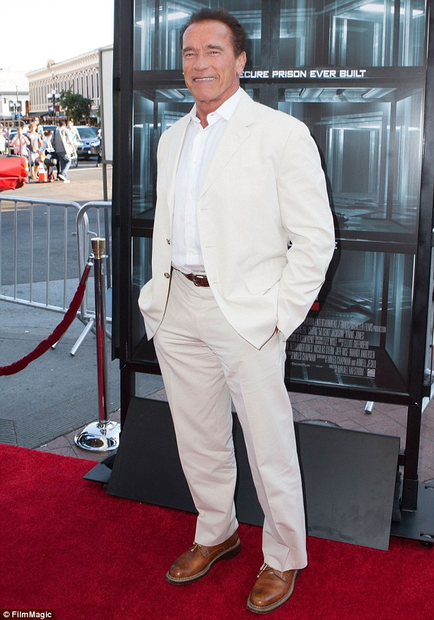Business as usual: Appearing to leave politics behind, Arnold Schwarzenegger grinned at the premiere of Escape Plan at ComicCon in July, in which he stars with Sylvester Stallone