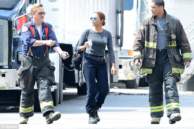 Spot the difference: it was hard to tell Monica and her cast mates (L-R) Christian Stolte and Charlie Barnett apart from real firefighters