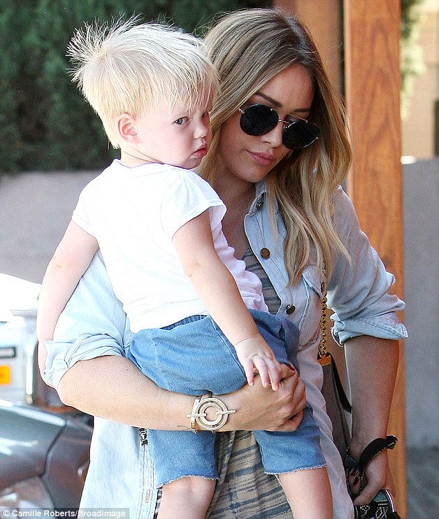 Cute kid: Luca looked adorable as Hilary carried him around