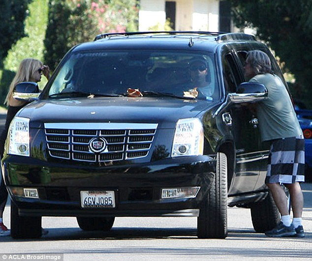 What a life: Goldie, Kurt and Adam stopped to chat in picturesque Brentwood, LA