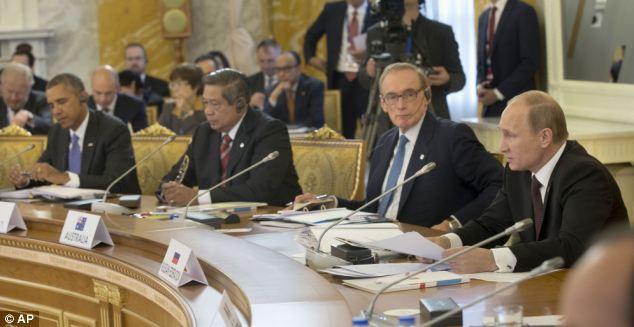 President Barack Obama, left, listens as Russian President Vladimir Putin, right, speaks during the start of the G-20 Working Session