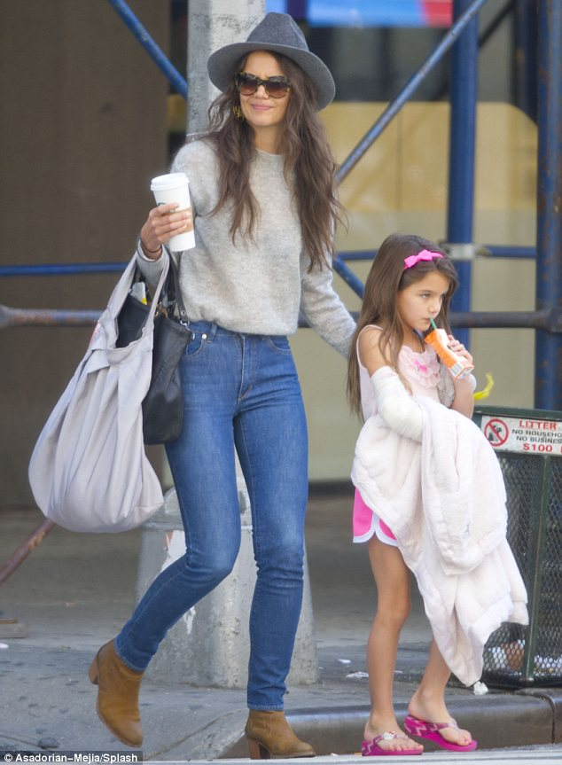 Treat: Katie and Suri stopped off for drinks before continuing to run errands in New York