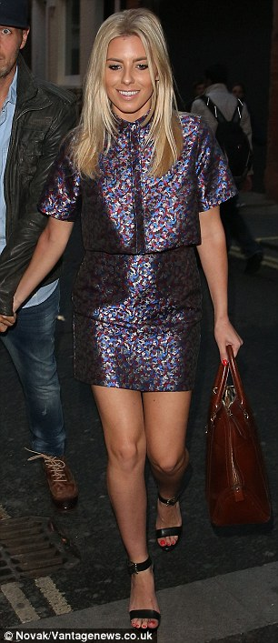 Dressing to impress: Evidently keen to impress her record producer beau during his brief stint in the UK, the 26-year-old singer showcased her style credentials in a chic metallic mini and matching structured blouse