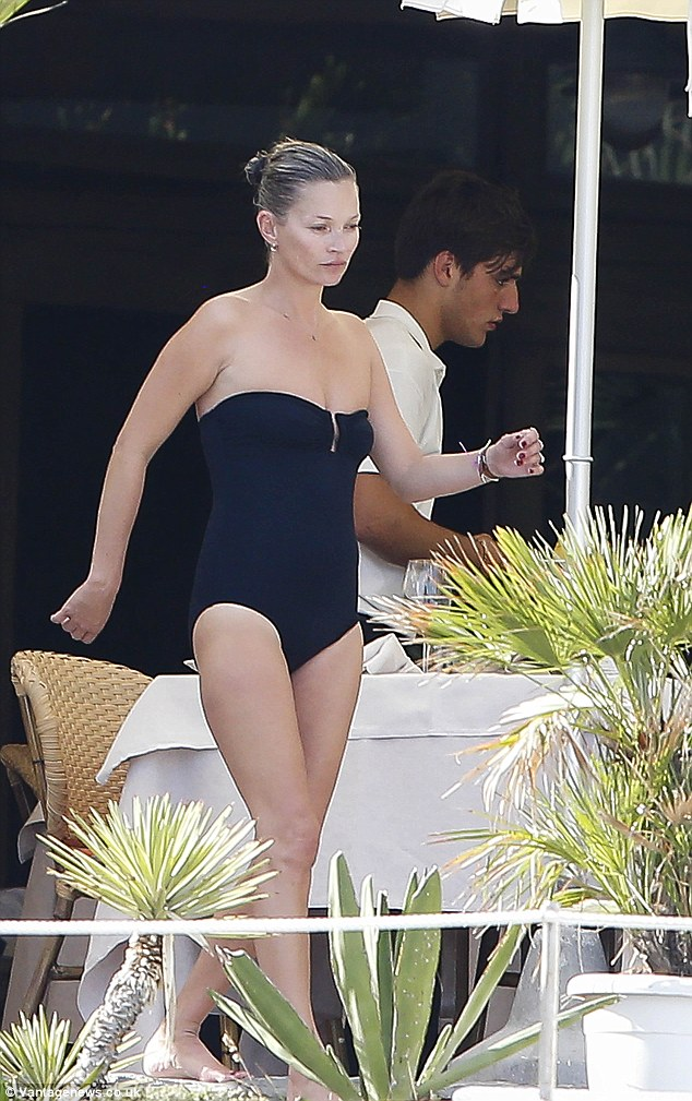 Still got it: Kate Moss looked fantastic in her one piece black swimsuit the day after the wedding of friend Jean-Yves le Fur and polish model Malgosia Bela on Li Galli island near Positano in Italy