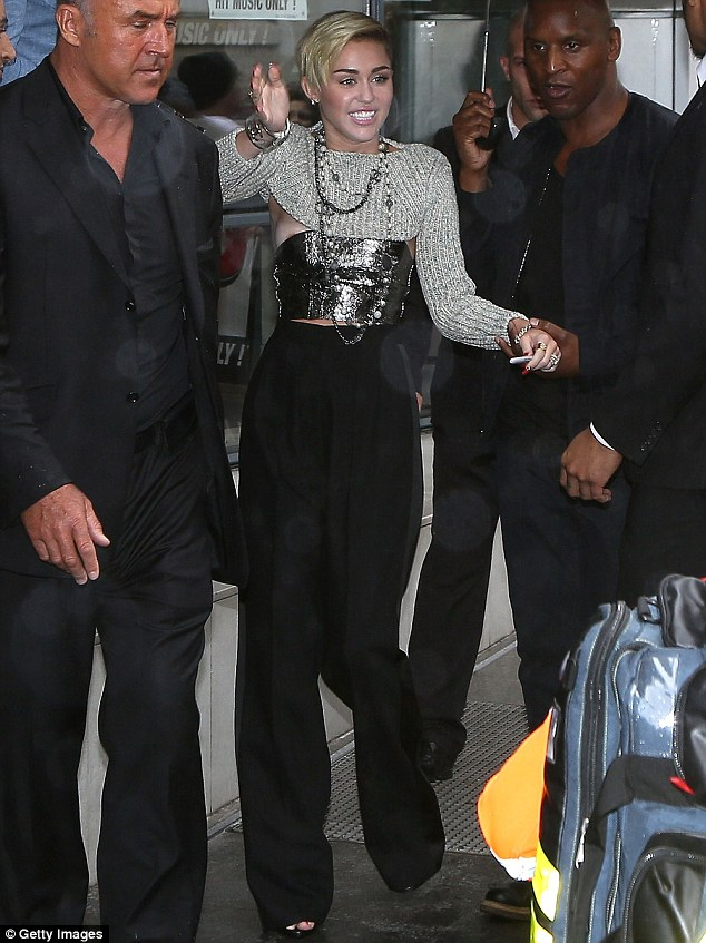Losing shock value: Miley endured what could be described as a wardrobe malfunction in Paris on Monday, though given her form it's hard to tell