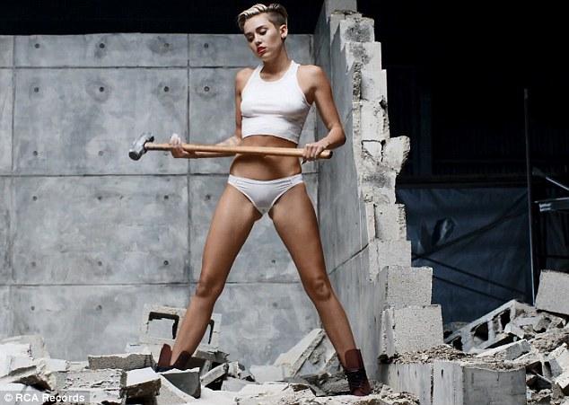 Cowboy builder: Miley seems pretty handy with a sledgehammer