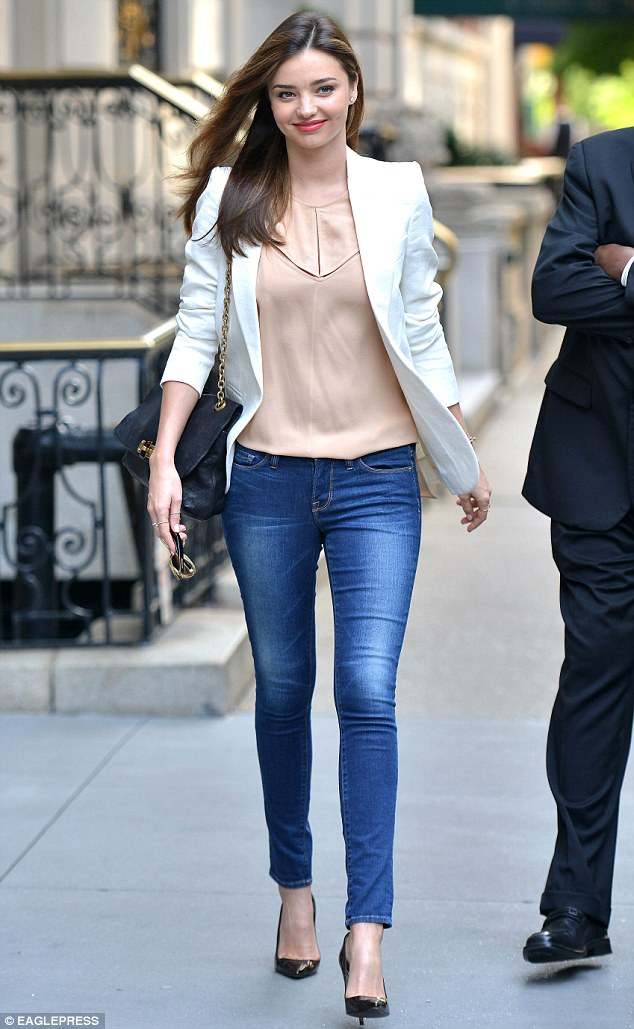 Fun and feminine: Miranda Kerr stepped out in a demure but still sexy look on Monday in New York