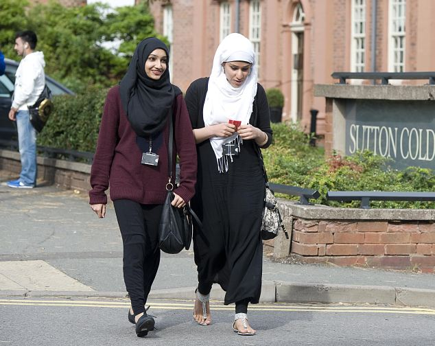 Two Muslim students at the Birmingham Metropolitan College campus in Sutton Coldfield, West Midlands. The college have banned Muslim girls from wearing a veil
