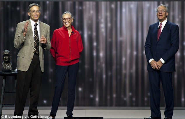 Alice Walton, Jim Walton (left) and Rob Walton (right), chairman of Wal-Mart Stores Inc., speak at the company's annual shareholders meeting in Fayetteville, Arkansas, in June 2012