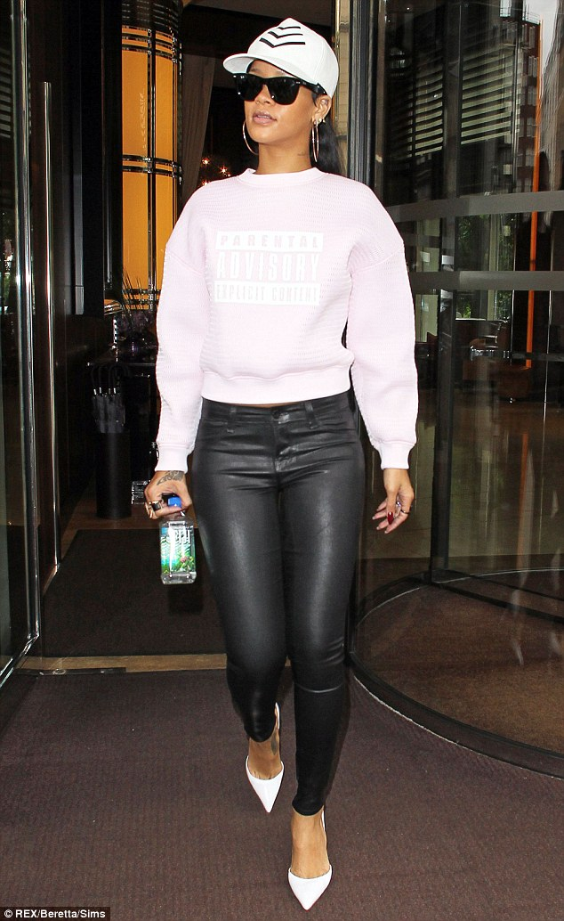Warning: Rihanna laughs off her raunchy reputation with a tongue in cheek slogan sweater