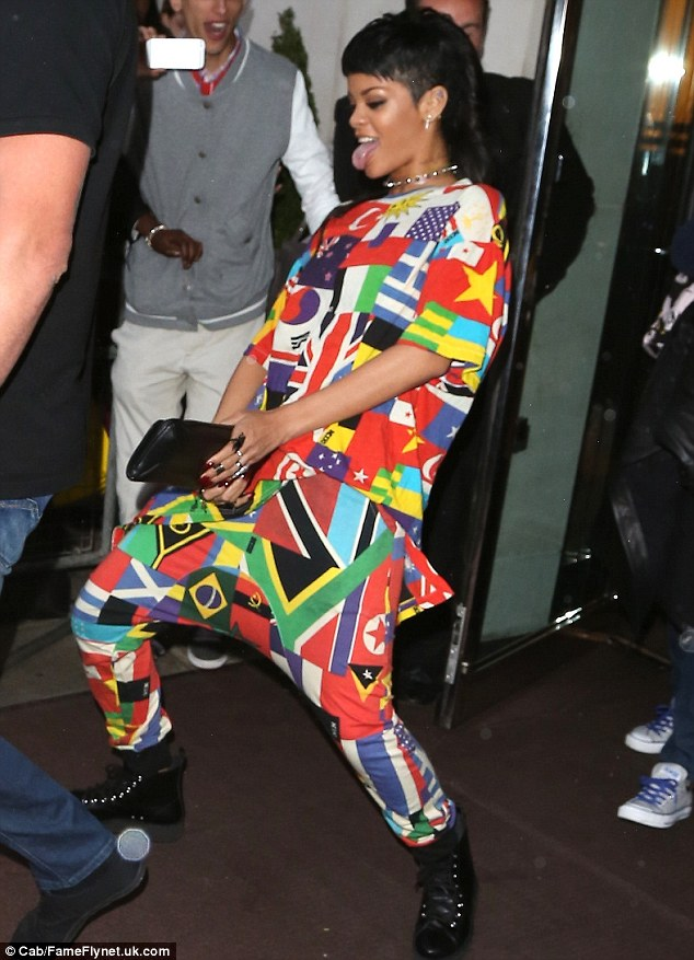 All around the world: Rihanna left her hotel on Wednesday evening wearing a brightly coloured trouser and top combination