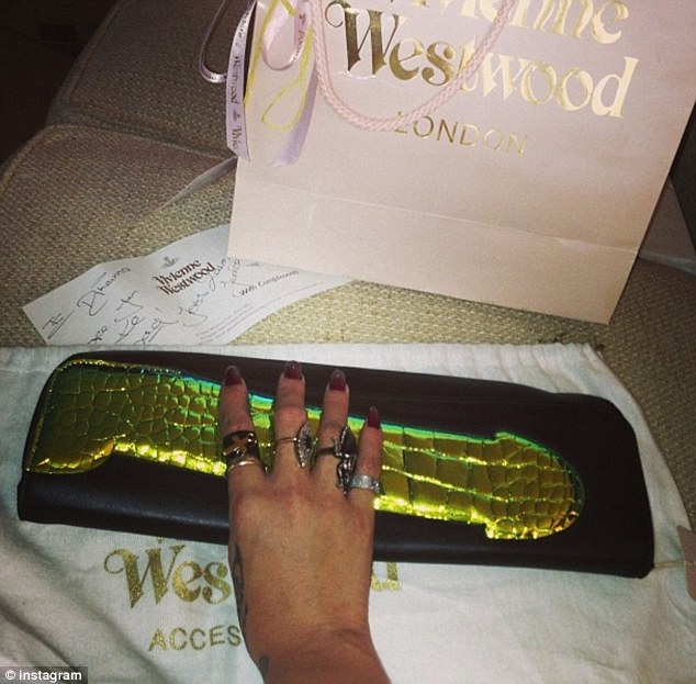 New gift: Rihanna took to Twitter to share a picture of the clutch she had been given from Vivienne Westwood