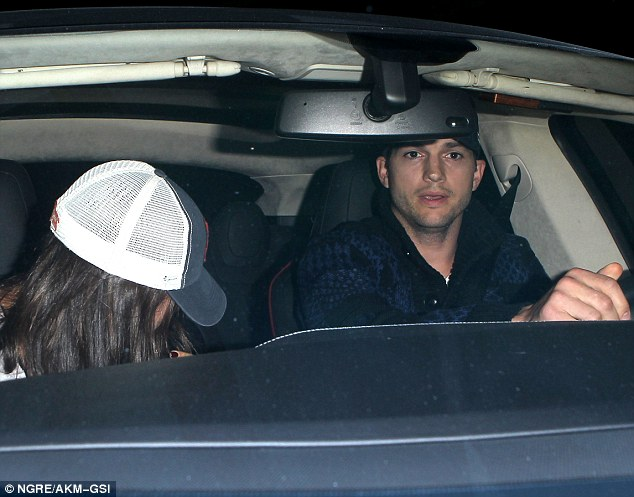 Jetting in: Ashton Kutcher, 35, was spotted picking up girlfriend Mila Kunis, 30, from LAX on Tuesday night - the day after he was seen chatting happily to his ex-wife Demi Moore after the pair shared a flight