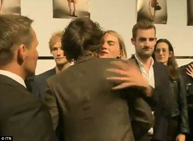 Pucker up: Last year Cara and Harry caused a frenzy after they were spotted kissing at a party