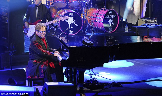 Belting it out: Sir Elton delighted fans in The Roundhouse as he performed songs old and new