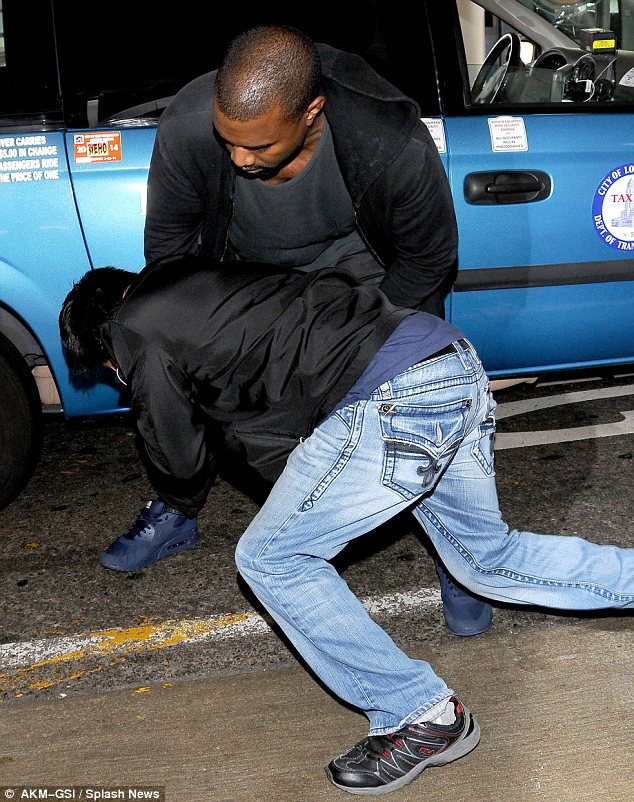 Lashing out: The rapper lost his temper at the snapper as he left the terminal
