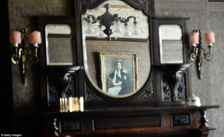 Valuable: A portrait of the Queen is reflected in an antique dresser in one of the rooms