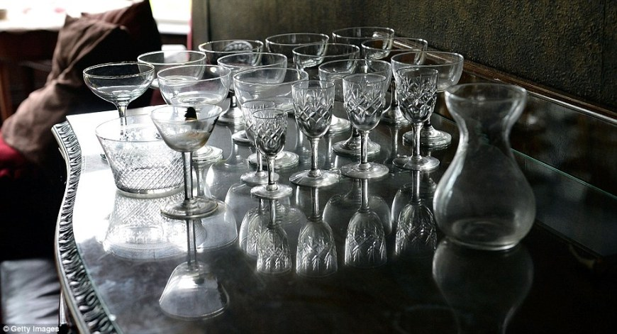Glassware: Sherry and cocktail glasses on a table in a dining room in Pineheath house which were rolled out when the couple entertained