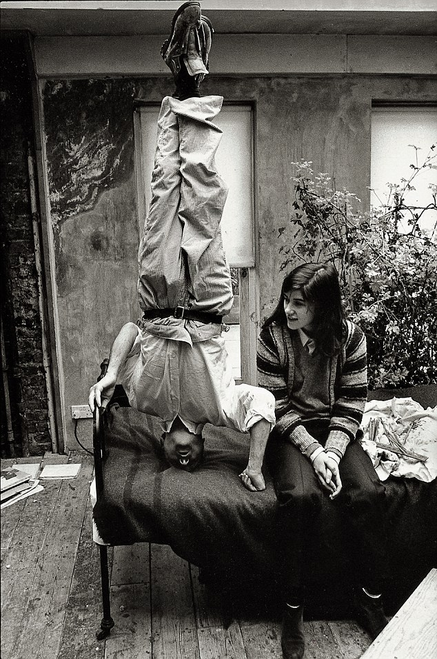 Lucian Freud standing on his head in his studio with his daughter, the fashion designer Bella Freud.