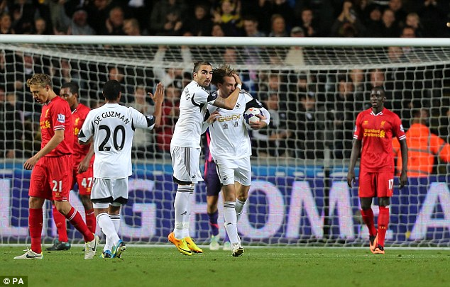 Nice work: Michu celebrates after stroking home Swansea's second goal of the match