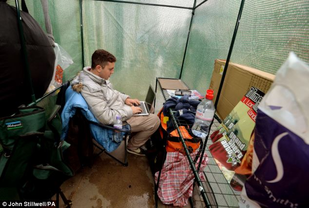 Dedicated: Gad Harari, 17, has set up camp outside Apple's flagship store in Regent Street, London, in a makeshift tent as part of a four-day wait for the iPhone 5S