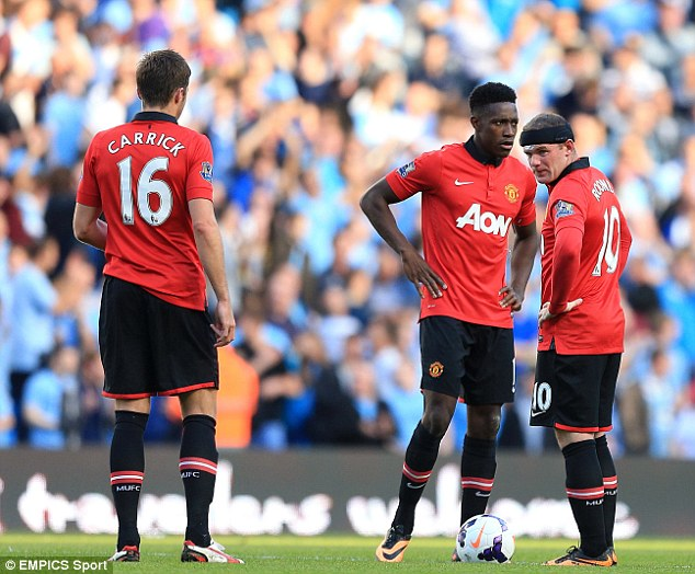 Not going to plan: Wayne Rooney, Danny Welbeck and Michael Carrick stand dejected after conceding another goal