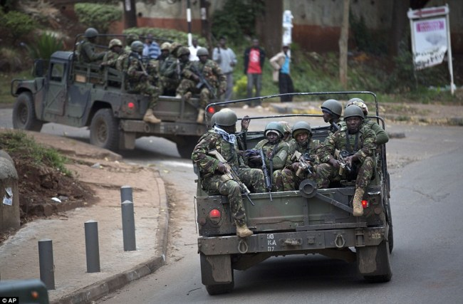 Here they come to save the day: Kenya Defense Forces arrive outside the Westgate Mall just after dawn, it didn't take long for the gunmen to start firing at them